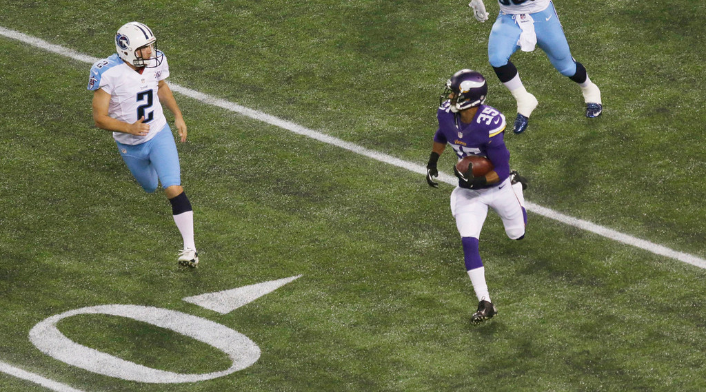 . Minnesota\'s Marcus Sherels, right, runs from Titans kicker Rob Bironas while returning a kickoff 109 yards for a touchdown to open the second half. (AP Photo/Jim Mone)