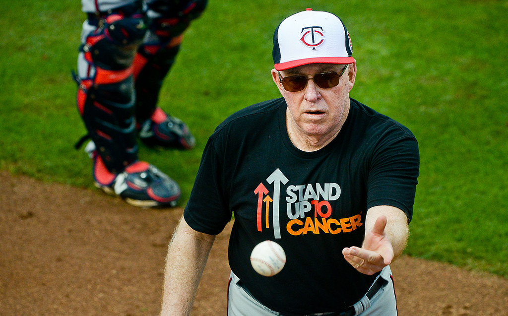 """. Former Twins manager Tom Kelly tosses a ball to first base as part of his infield drill called \""""Good Morning America.\"""" (Pioneer Press: Ben Garvin)"""