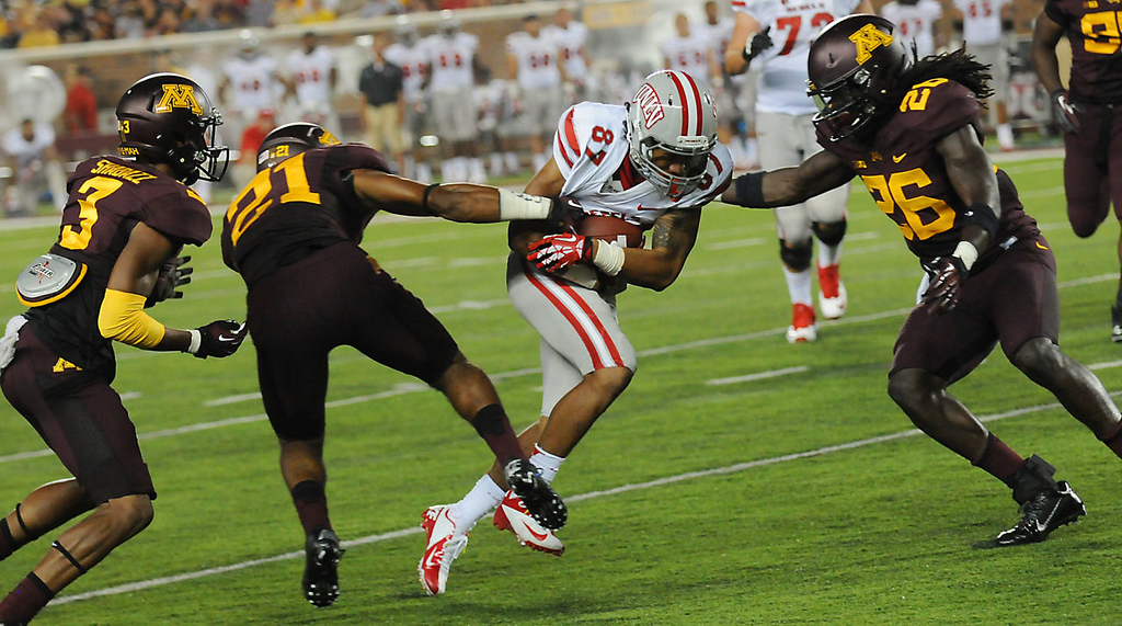 . UNLV wide receiver Maika Mataele tries to pick up some extra yards against Minnesota\'s De\'Vondre Campbell, right, defensive back Brock Vereen, left, and Martez Shabazz, far left, during the third quarter. (Pioneer Press: John Autey)