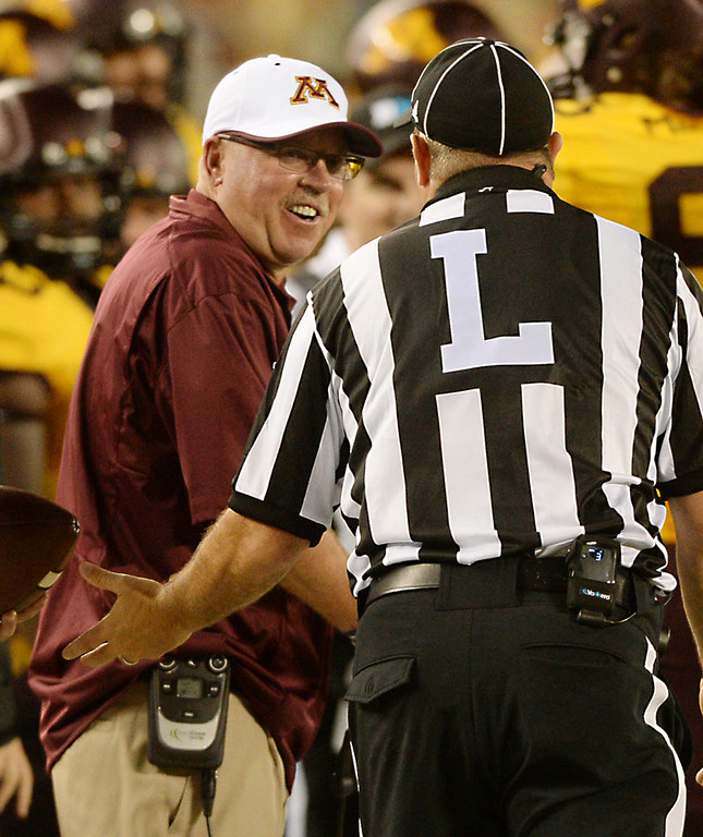 . Minnesota head coach Jerry Kill listens with skepticism to a referee\'s explanation of a non-call in the third quarter. (Pioneer Press: John Autey)