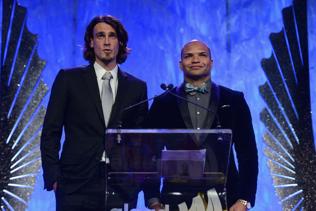 . NFL atheletes Chris Kluwe and Brendon Ayanbadejo speak onstage at the 24th Annual GLAAD Media Awards on March 16, 2013 in New York City.  (Photo by Jamie McCarthy/Getty Images for GLAAD)