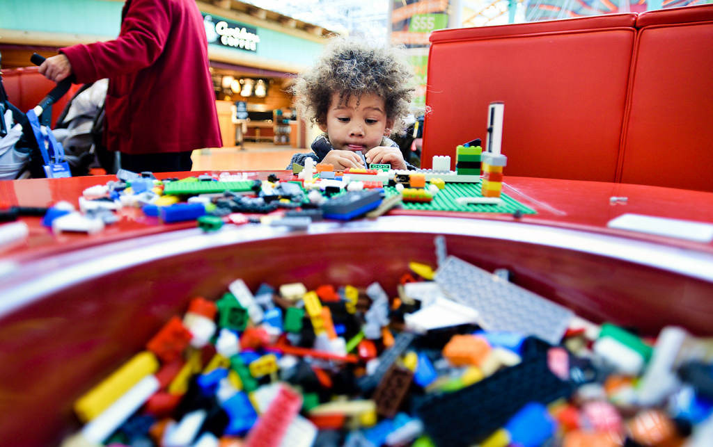 ". Two-year-old Cadden Kostrzewski of Eagan plays with Legos at the Lego store. ""He\'s into Star Wars \'cause his dad is really in to Star Wars,\"" said Cadden\'s mother. (Pioneer Press: Ben Garvin)"