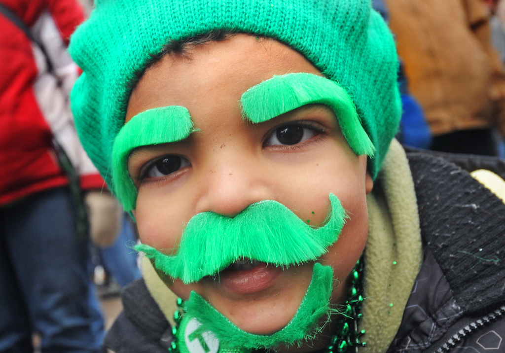 ". Three-year-old Cashton Broussard of Roseville glued some additional facial ""hair,\"" the better to blend in with the rest of the crowd, during the 48th annual St. Patrick\'s Day Parade along East Fiftth Street in downtown St. Paul on Monday, March 17, 2014.  (Pioneer Press: Scott Takushi)"