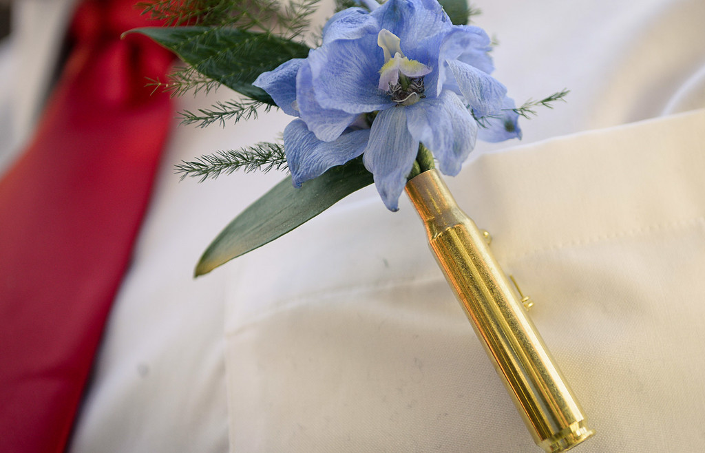 . Corsages were made from sniper casings for Cody Bauman and Paige Collins\'s wedding. (Pioneer Press: Ben Garvin)