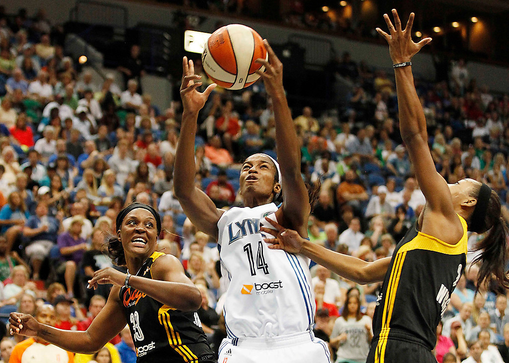 . Minnesota Lynx forward Devereaux Peters (14) grabs a rebound from Tulsa Shock forward Tiffany Jackson-Jones (33) and guard Candice Wiggins, right, in the second half. (AP Photo/Stacy Bengs)