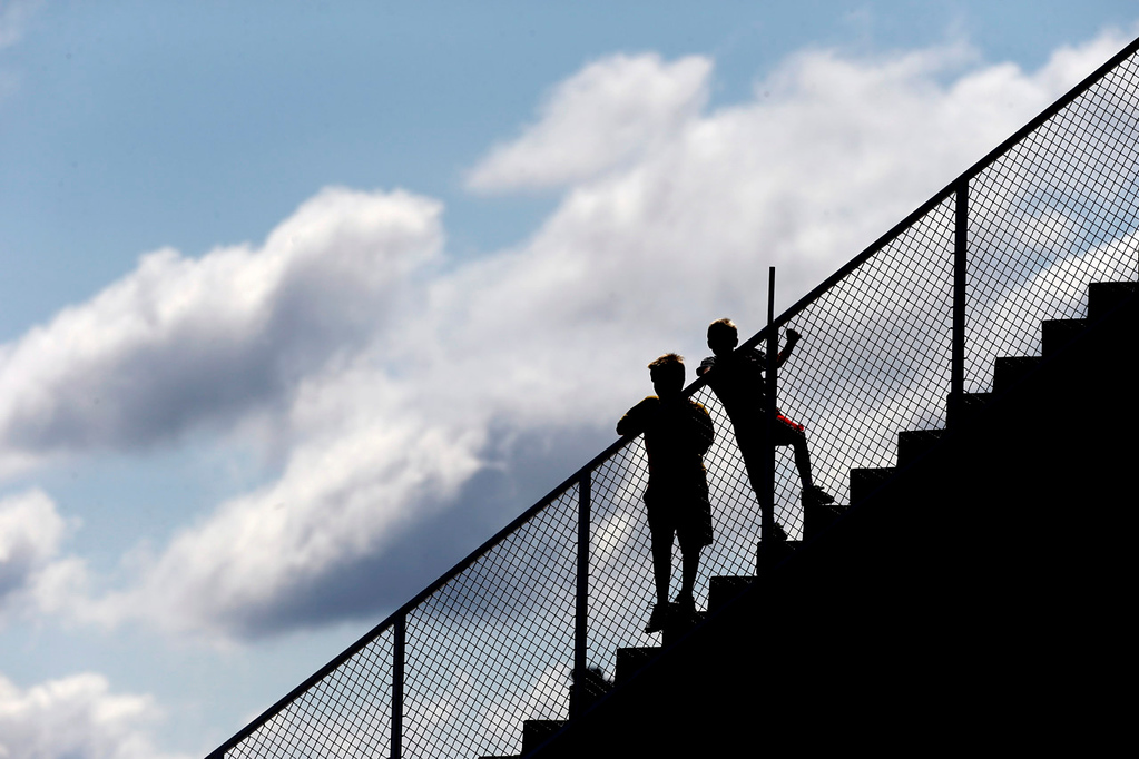 . A pair of Vikings fans get an elevated view of the team\'s pracice. (AP Photo/Charlie Neibergall)