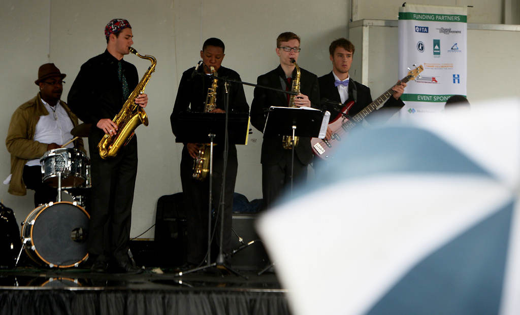 . A band plays for a a half dozen people at the Victoria Street Station festivities during the Metro Transit Green Line Grand Opening in St. Paul, Saturday June 14, 2014. Most the station evens were cancelled due to dangerously high winds and rain. (Pioneer Press: John Autey)