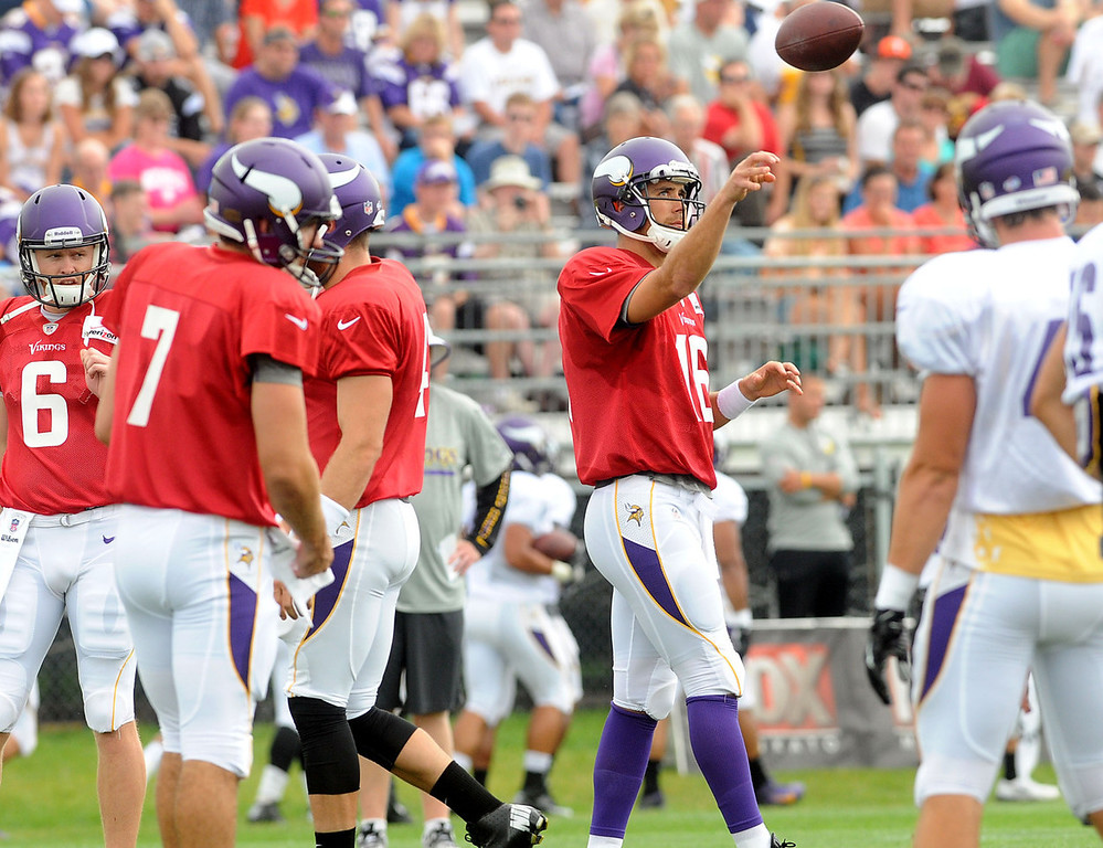 . Vikings quarterback Matt Cassel, center, tosses a ball while waiting for the next snap along with quarterbacks (from left) James Vandenberg, Christian Ponder and McLeod Bethel-Thompson during afternoon practice.  (Pioneer Press: Sherri LaRose-Chiglo)