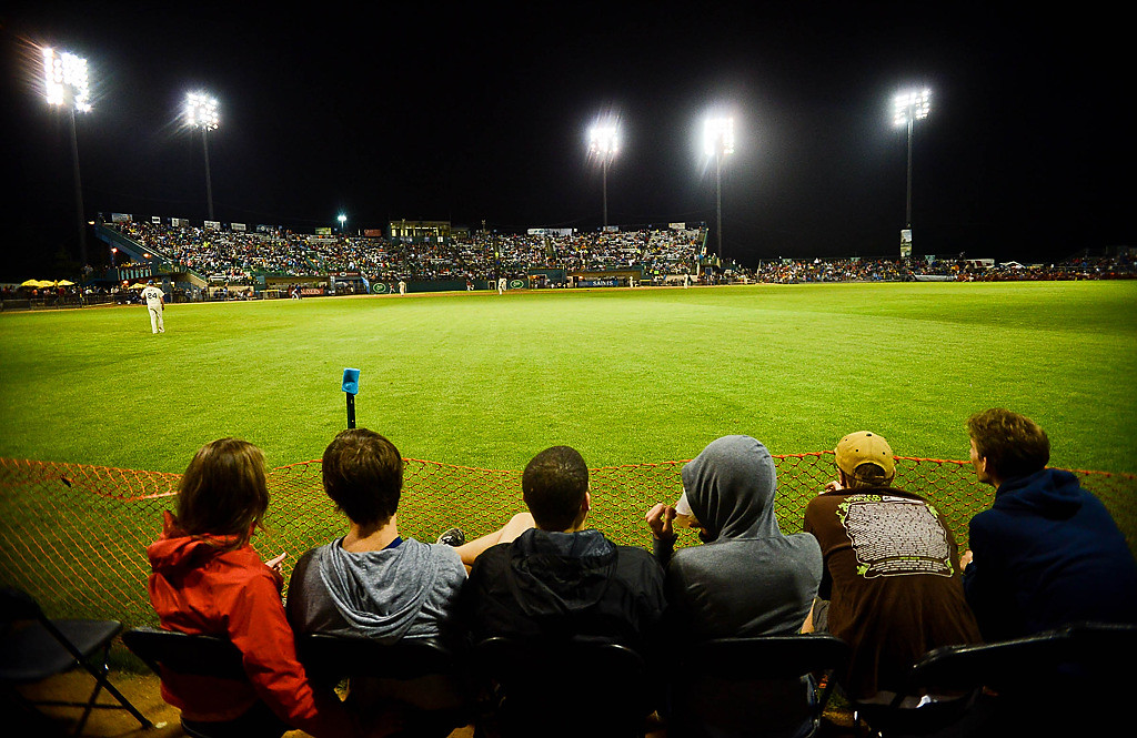 . Fans watched from the warning track in the outfield as the St. Paul Saints play their last game at Midway Stadium. (Pioneer Press: Ben Garvin)