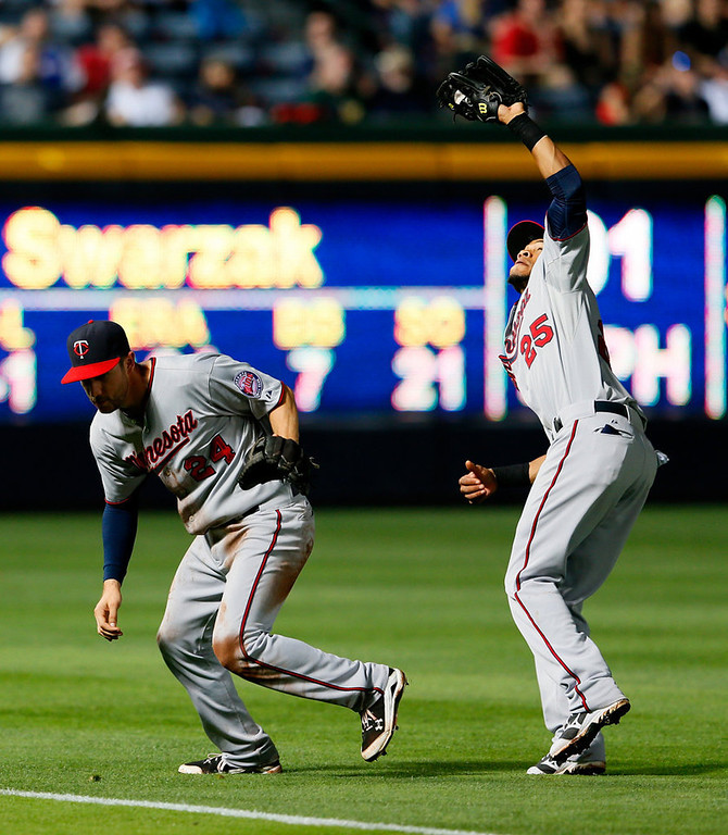 . Pedro Florimon of the Minnesota Twins catches a pop fly by Juan Francisco of the Atlanta Braves after calling off third baseman Trevor Plouffe in the sixth inning.  (Photo by Kevin C. Cox/Getty Images)