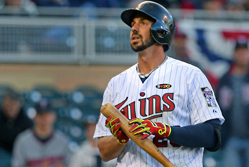 . Minnesota first baseman Chris Colabello walks back to the dugout after swinging at a slider for strike three against Oakland relief pitcher Ryan Cook for the final out of the game. (Pioneer Press: John Autey)