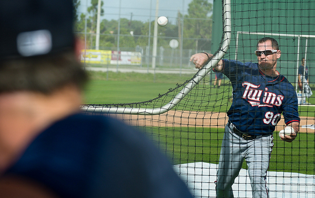 . Spring training coach Tim Doherty throws a pitch during batting practice. (Pioneer Press: Ben Garvin)