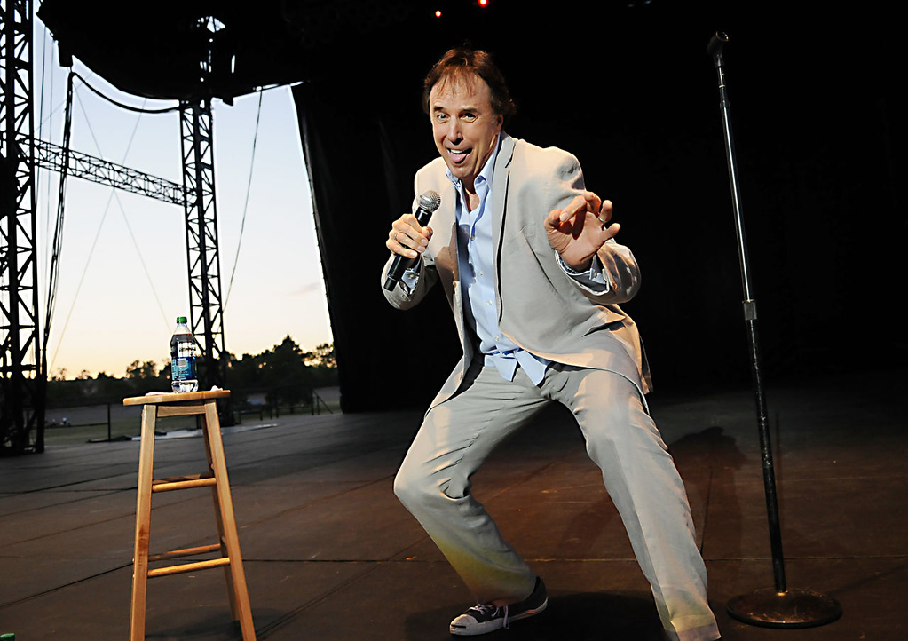 ". Comedian and actor Kevin Nealon, who appeared on ""Saturday Night Live\"" and other television shows, performs at the Minnesota State Fair Grandstand with other SNL alumni Dana Carvey and Dennis Miller on Thursday night, Aug. 22, 2013. (Pioneer Press: John Autey)"