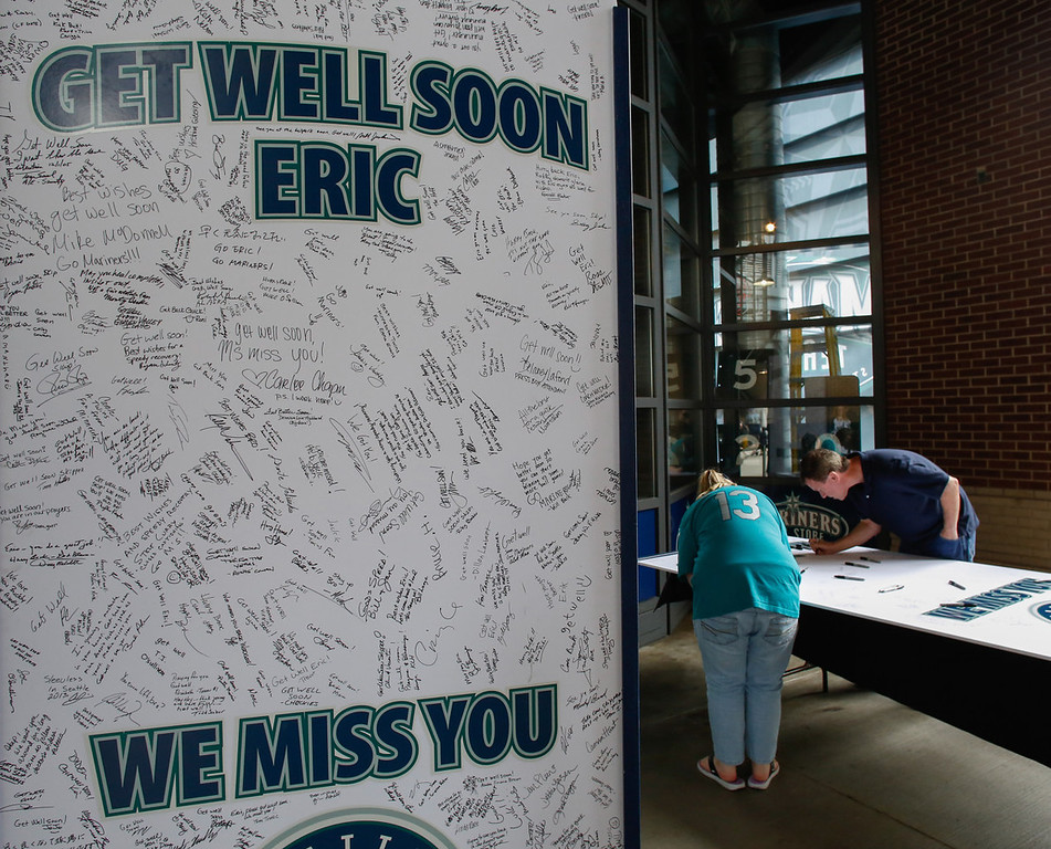 . Fans sign giant get-well cards for Mariners manager Eric Wedge, who is recovering from a mild stroke, prior to their game against the Twins.  (Photo by Otto Greule Jr/Getty Images)