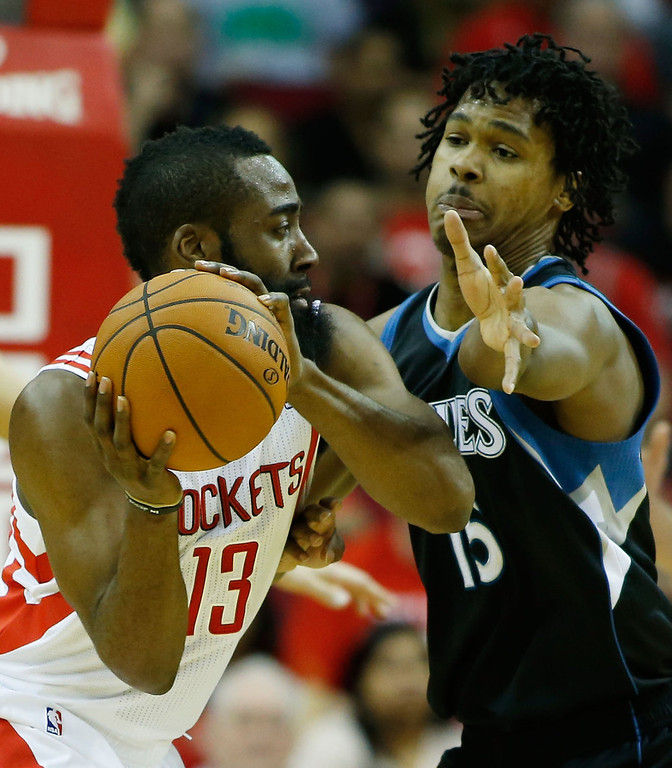 . James Harden #13 of the Houston Rockets looks to pass against Mickael Gelabale #15 of the Minnesota Timberwolves.  (Photo by Scott Halleran/Getty Images)