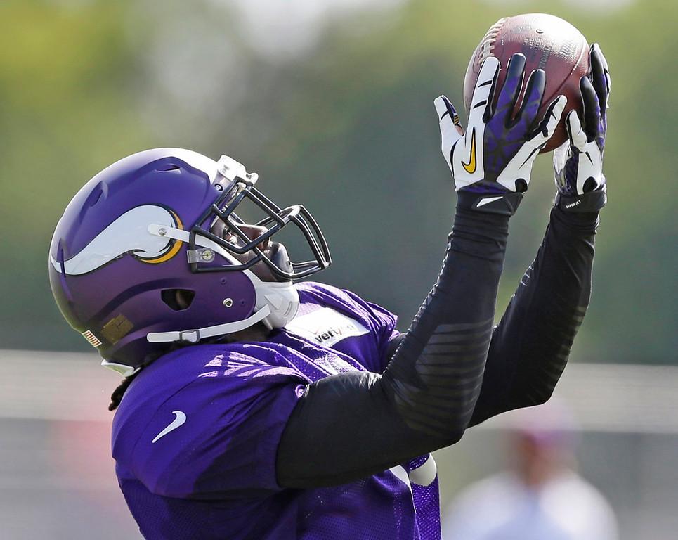 . Vikings wide receiver Stephen Burton snags a pass. (AP Photo/Charlie Neibergall)