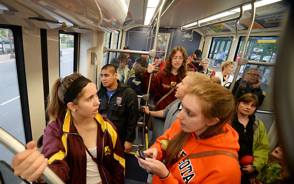 """. Lindsay Blahnik, left and Rachel Olson, both University of Minnesota Students ride the Green Line to St. Paul from the University during the Metro Transit Green Line. \""""We want to explore (St. Paul) more,\"""" said Olson. (Pioneer Press: John Autey)"""