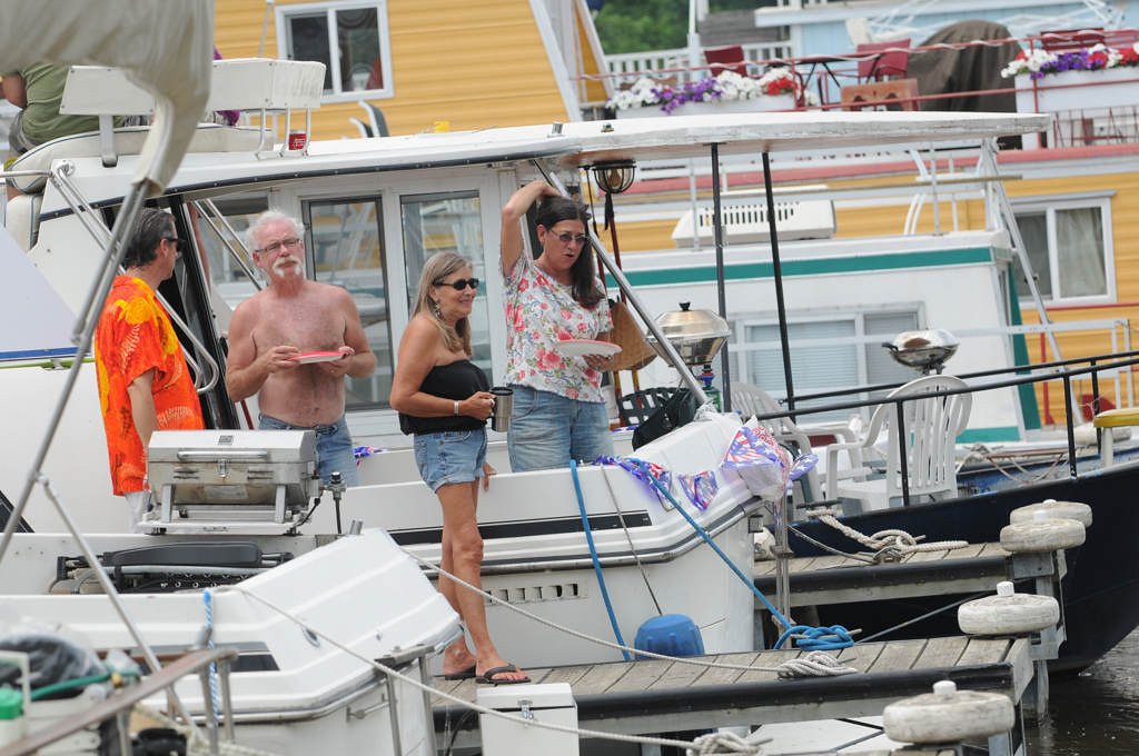 . People watch the logjam cleanup from their boats at the St. Paul Yacht Club.  (Pioneer Press: Jean Pieri)