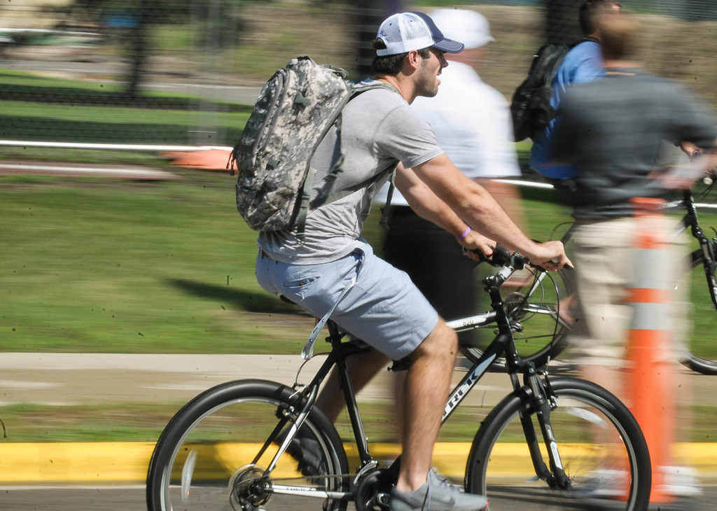 . Vikings quarterback Christian Ponder cruises on his bike to a team meeting after checking in at training camp.  (Pioneer Press: Ben Garvin)