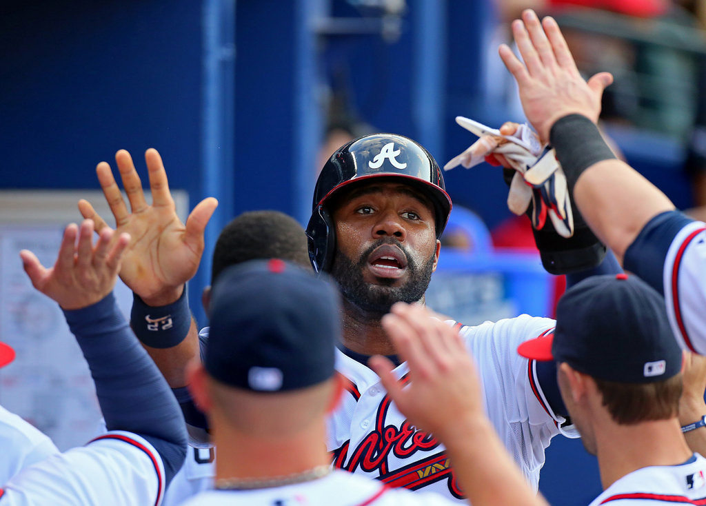 . The Braves\' Jason Heyward is congratulated after scoring on an RBI double by Freddie Freeman in the first inning. (Curtis Compton/Atlanta Journal-Constitution/MCT)