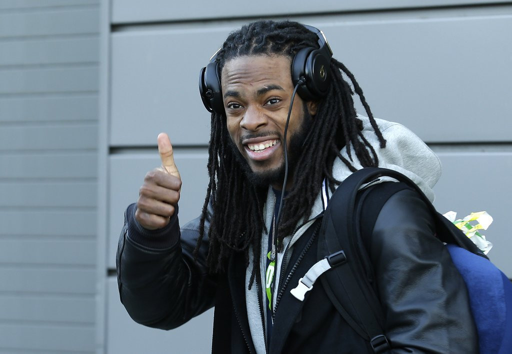 """. <p><b> Seattle cornerback Richard Sherman has become a household name since his NFC title game rant. As folks get to know more about it, they�re surprised to find out that he � </b> <p> A. Graduated from Stanford <p> B. Grew up on the hard streets of Compton <p> C. Is even more of a jerk in real life than on TV <p><b><a href=\'http://money.cnn.com/2014/01/24/news/companies/richard-sherman-rant/\' target=\""""_blank\"""">HUH?</a></b> <p>   (AP Photo/Ted S. Warren)"""
