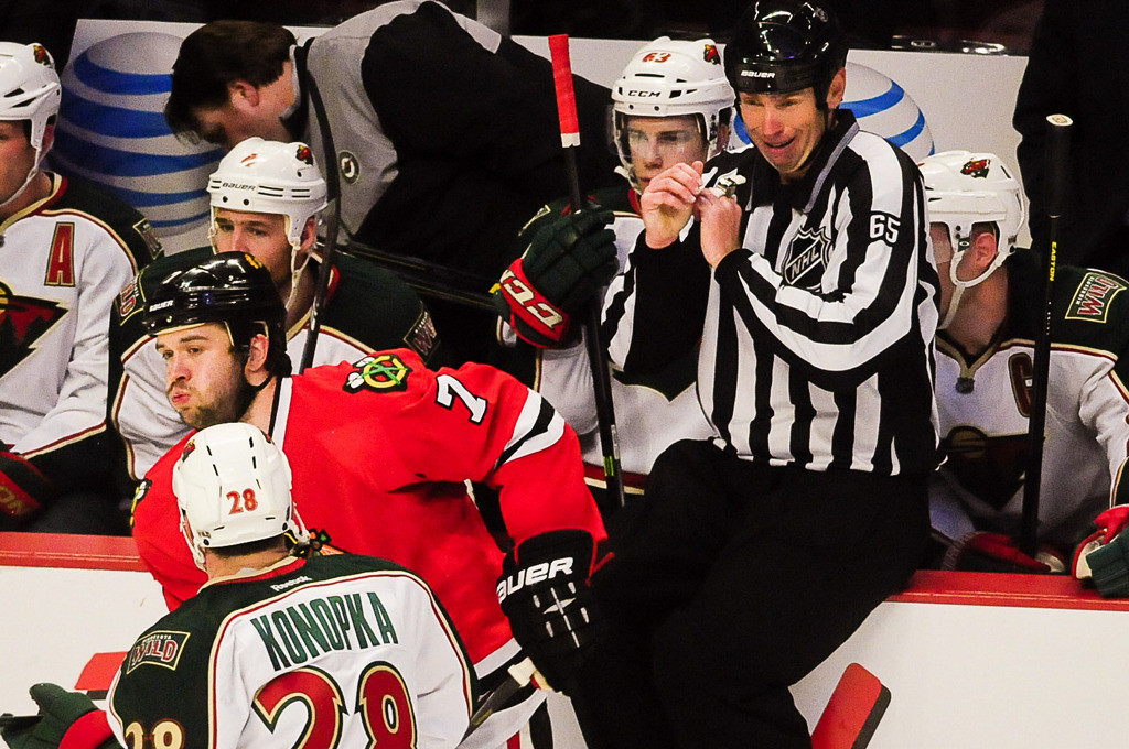 . A scared referee sits up the rail trying to avoid being hit in the third. (Pioneer Press: Ben Garvin)