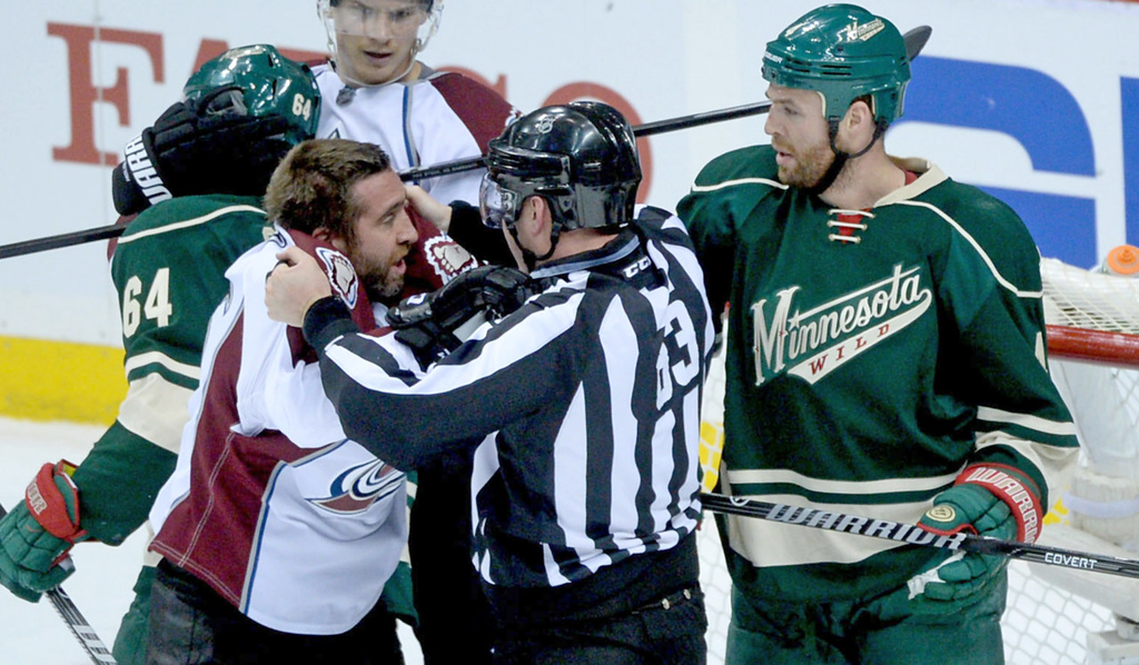 . Linesman Matt MacPherson gets in between Colorado\'s MaximeTalbot, left, and Minnesota\'s Clayton Stoner, right, during the first period. (Pioneer Press: Sherri LaRose-Chiglo)