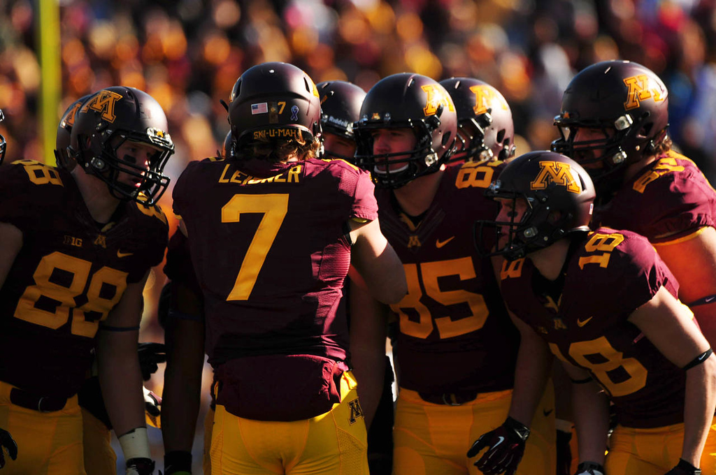 . Minnesota quarterback Mitch Leidner huddles with his team during the first quarter. From left: tight end Maxx Williams, Leidner, tight ends Lincoln Pisek and Derrick Engel.  (Pioneer Press: Scott Takushi)