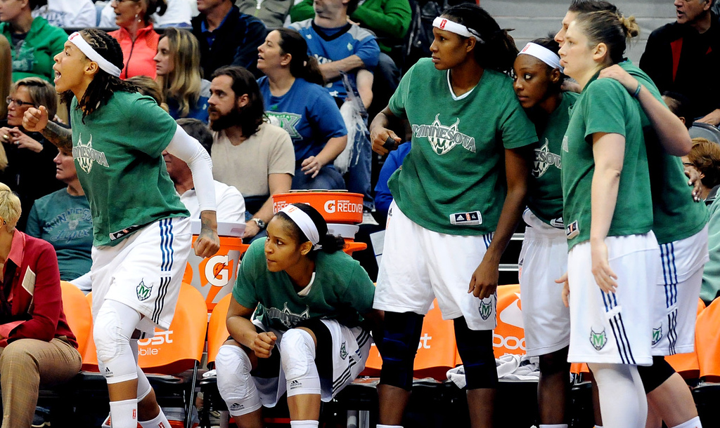 . Lynx players (from left) Seimone Augustus, Maya Moore, Rebekkah Brunson, Monica Wright, Janel McCarville, and Lindsay Whalen watch the final seconds of Minnesota\'s 84-59 win over Atlanta from the bench. (Pioneer Press: Sherri LaRose-Chiglo)