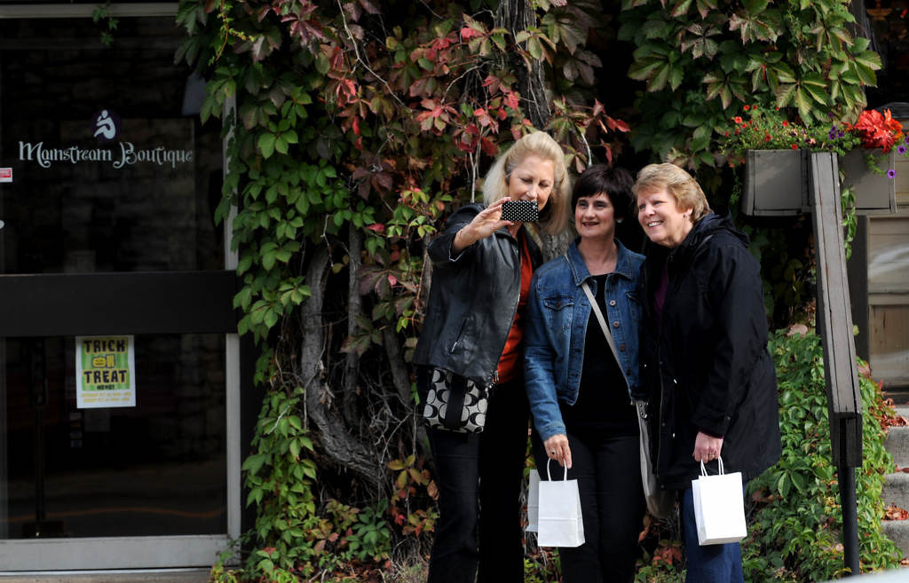 """. Sandy McKown, Elsie Esco and Sue Matz of Minneapolis pose for a picture during a \""""friend outing\"""" on Main Street in Stillwater in October 2013. (Pioneer Press: Jean Pieri)"""
