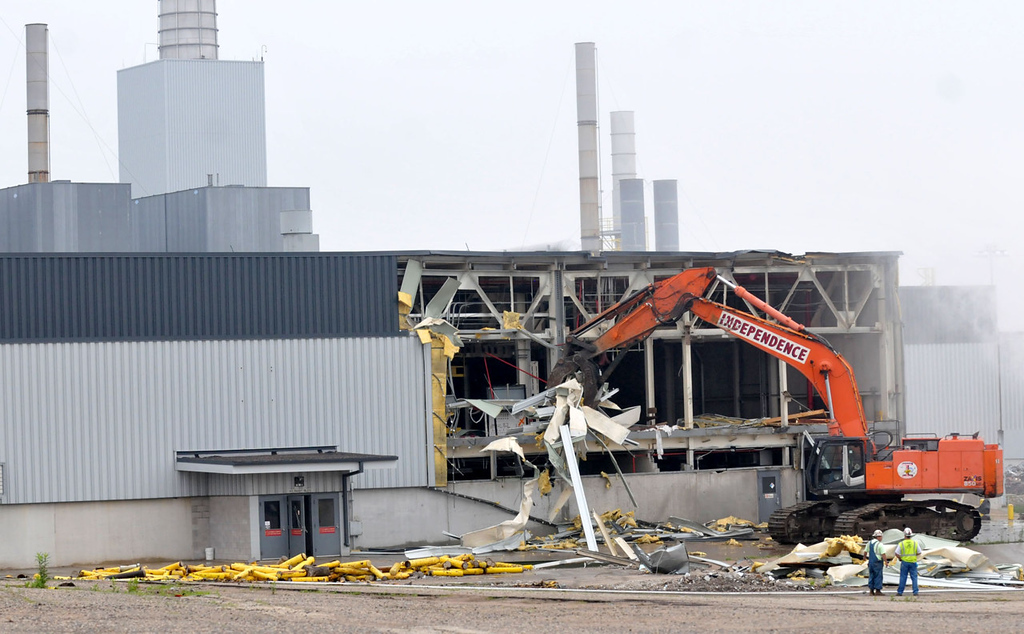 . An excavator rips off the metal facade of the paint shop building as demolition of the Ford Twin Cities Assembly Plant in Highland Park began Monday morning June 10, 2013. The teardown of the entire Ford campus is tentatively scheduled to conclude in 2015, but land restoration could stretch into 2018.    (Pioneer Press: John Doman)