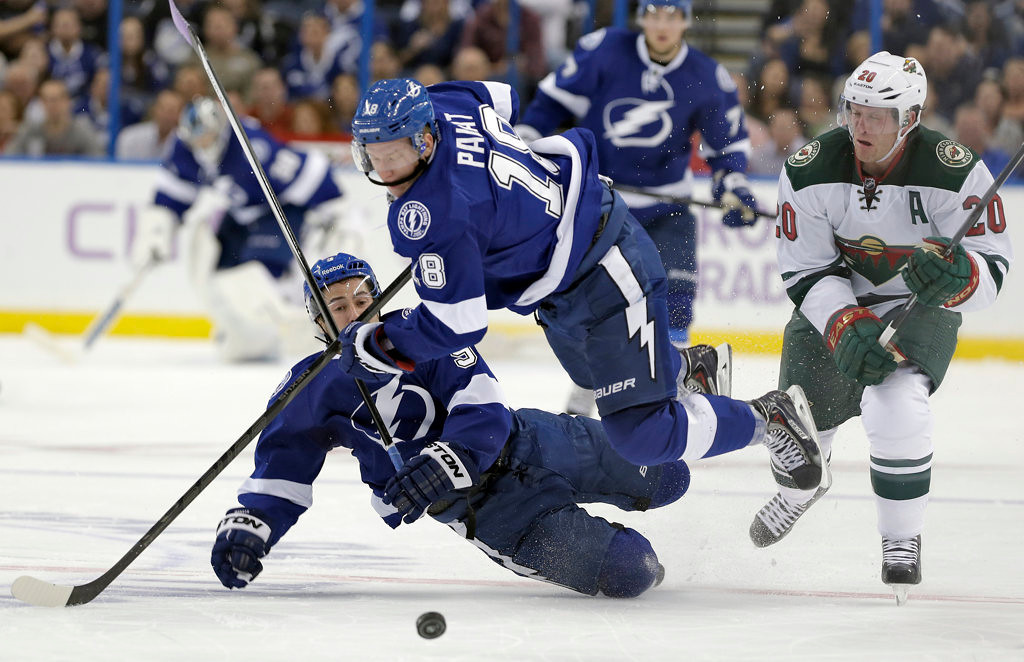 . Tampa Bay Lightning center Tyler Johnson (9) and left wing Ondrej Palat (18), of the Czech Republic, collide after getting the puck past Minnesota Wild defenseman Ryan Suter (20) during the second period. (AP Photo/Chris O\'Meara)