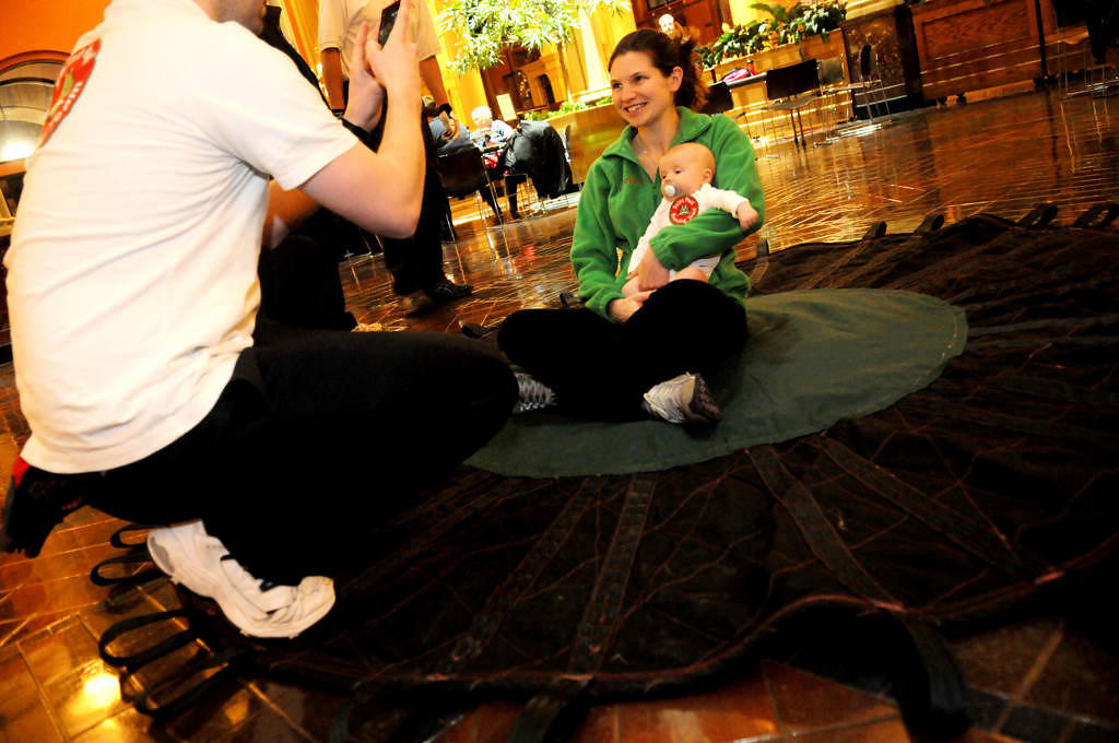 . Outgoing senior Bounce Girl Christine Pearson poses on the blanket with her 11 week old son Joseph Pearson as her husband Jeff Pearson takes photographs. (Pioneer Press: Sherri LaRose-Chiglo)