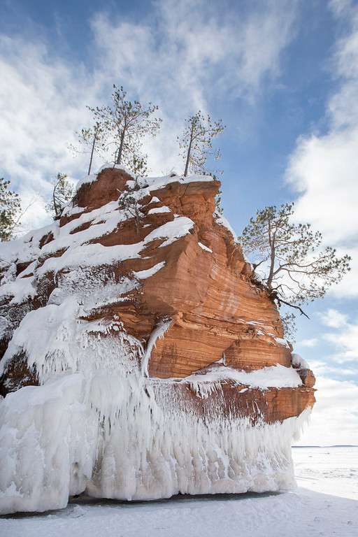 . Trees sit atop a frozen cliff at the Apostle Islands National Lakeshore. (Pioneer Press: Andy Rathbun)