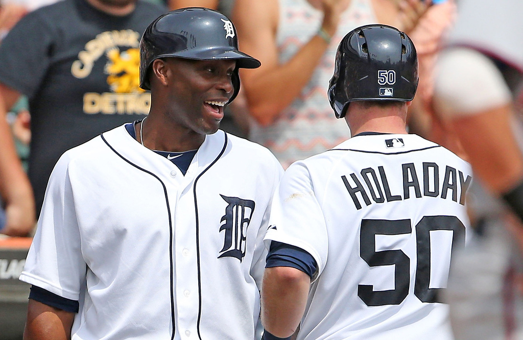 . Detroit\'s Bryan Holaday gets the thousand-watt smile from teammate Torii Hunter after hitting a solo shot, his first career major league homer, in the third inning against the Twins.  (Photo by Leon Halip/Getty Images)