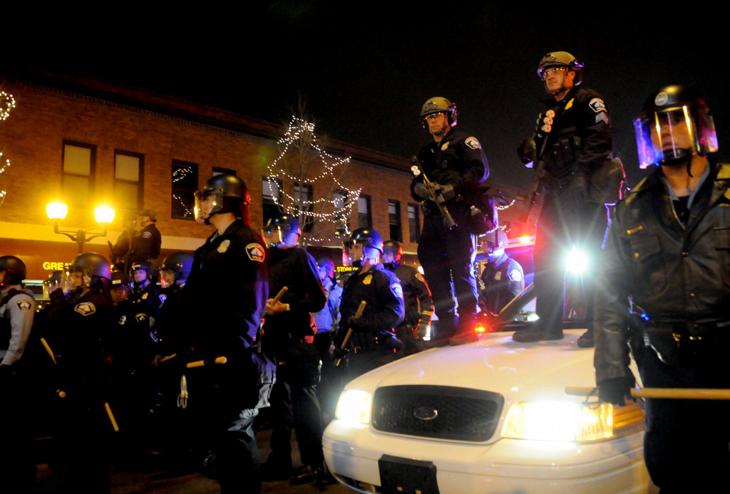 . Mnneapolis police stand in position in case fans get out of hand in Dinkytown on Saturday night in Minneapolis. (Pioneer Press: Sherri LaRose-Chiglo)