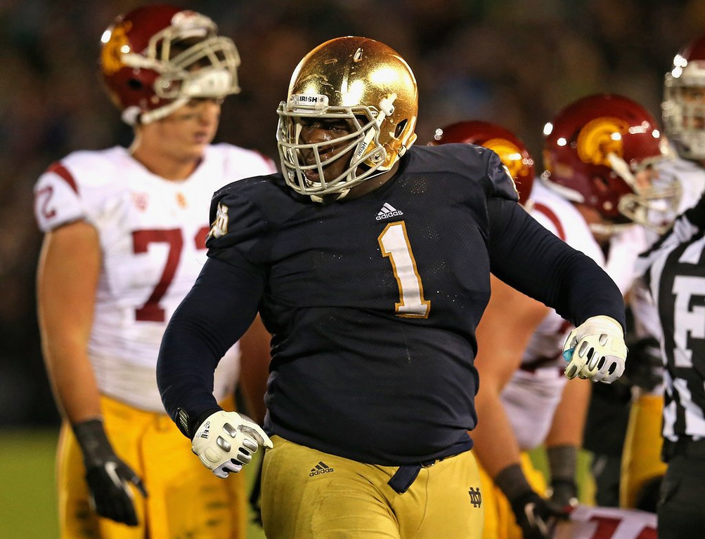 ". <p><b>32. Seattle: Louis Nix III, DT, Notre Dame. </b> <p>It might be somewhat painful for former USC coach Pete Carroll to take a Fighting Irish star, but the Seahawks could use help on the defensive line.  <p>Follow Chris Tomasson at <a href=""http://twitter.com/christomasson\"">twitter.com/christomasson</a>.   (Jonathan Daniel/Getty Images)"