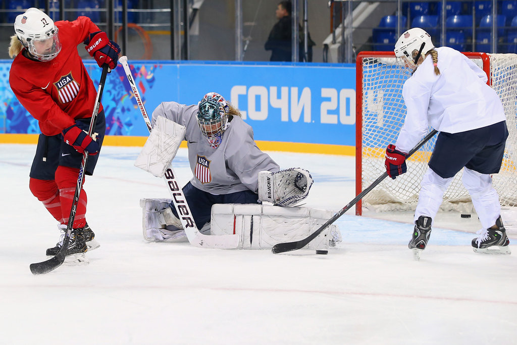 . From left, Jocelyne Lamoureux, Jessie Vetter and Kendall Coyne of the United States practice at Shayba Arena on February 3, 2014 in Sochi, Russia.  (Getty Images: Bruce Bennett)