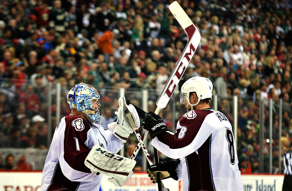 . Colorado Avalanche defenseman Jan Hejda, right, brings goalie Semyon Varlamov a new stick during the second period. (Pioneer Press: Ben Garvin)