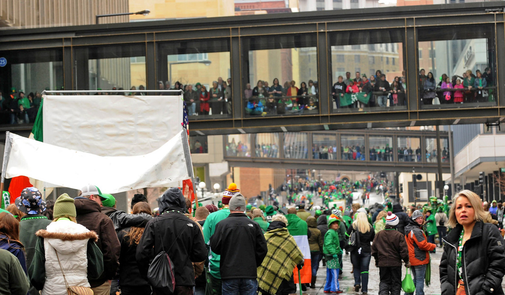 . With many spectators choosing the warmth of the skyways, the St. Patrick\'s Day parade makes its way from Mears Park to Rice Park along East Fifth Street.  (Pioneer Press: Scott Takushi)