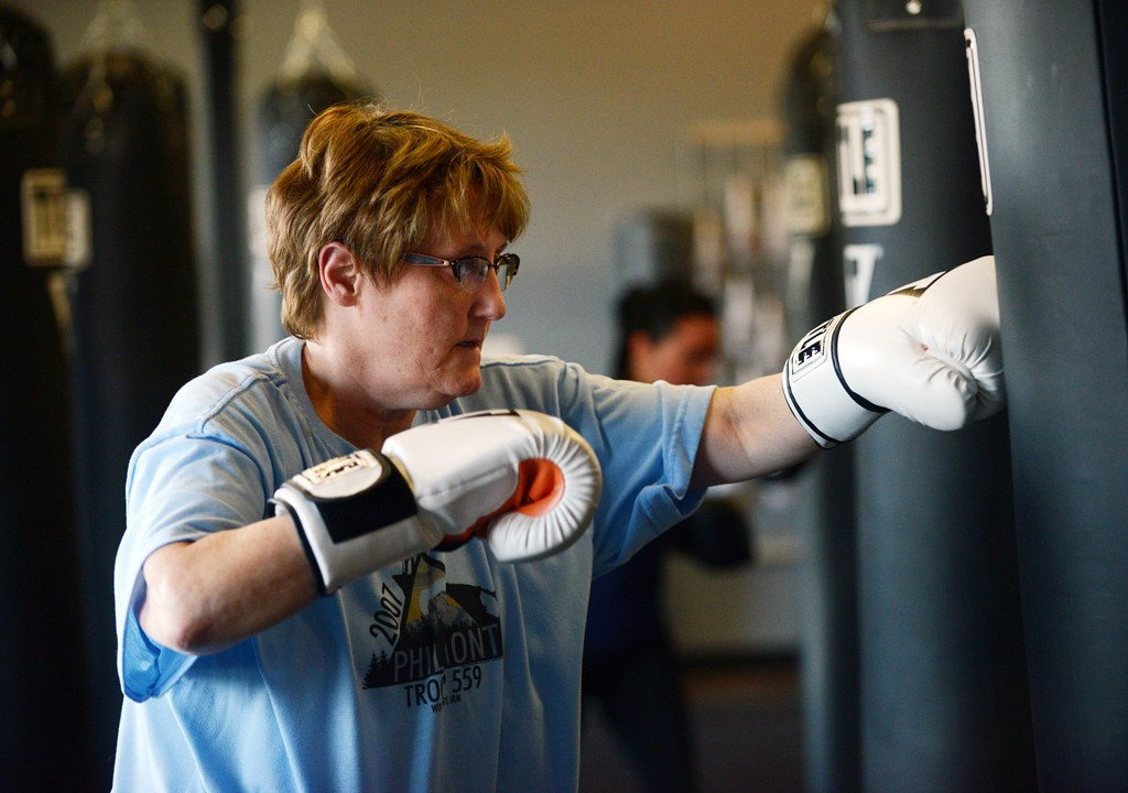 . Woodbury resident Janice Grizzell practices her punches on a heavy bag at Title Boxing Club in Woodbury.  Both her husband and son also take classes at the new club.  (Pioneer Press: Chris Polydoroff)