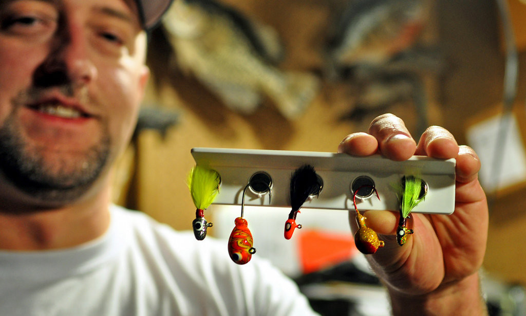""". Brad Yaritz displays a selection of lead-free jigs he sells on his website, CatchItOutdoors.com, in the basement of his White Bear Lake home Wednesday, Jan. 23, 2014. Yaritz made several of these jigs, made of glass and tin, for Eco-Jigs, the company he founded. \""""I catch tons of fish,\"""" says Yaritz, who uses the lures in walleye fishing tournaments. (Pioneer Press Dave Orrick)"""