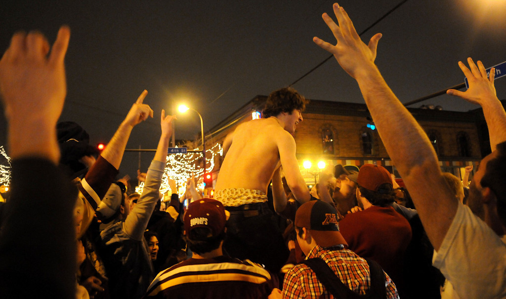 . Minnesota hockey fans take to  the street after the Frozen Four loss to Union. (Pioneer Press: Sherri LaRose-Chiglo)