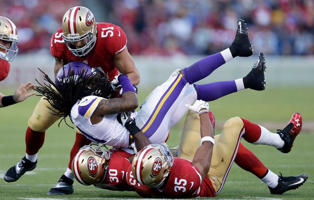 . Minnesota\'s Bobby Felder is tackled by 49ers linebacker Dan Skuta (51), free safety Trenton Robinson (30) and safety Eric Reid (35) during the third quarter. (AP Photo/Marcio Jose Sanchez)