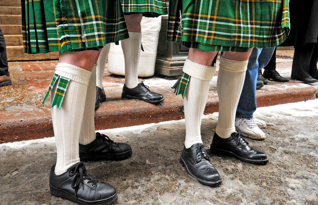 . Samantha, left, and Tim Branville of St. Paul have legs, and they know how to use them, sporting kilts of the Irish Free States, during the annual St. Patrick\'s Day parade.  (Pioneer Press: Scott Takushi)