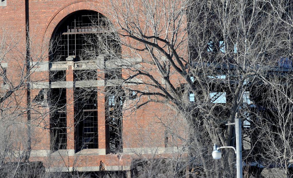 . Large broken windows an hour before demolition crews took down the Island Station coal power plant at 380 Randolph Avenue in St. Paul.  (Pioneer Press: Sherri LaRose-Chiglo)