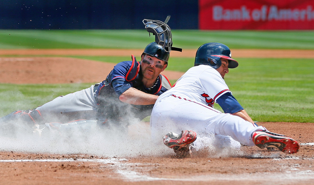 . Twins catcher Ryan Doumit tags out Atlanta\'s Ramiro Pena at the plate in the first inning on a throw from left fielder Josh Willingham.  (Photo by Kevin C. Cox/Getty Images)