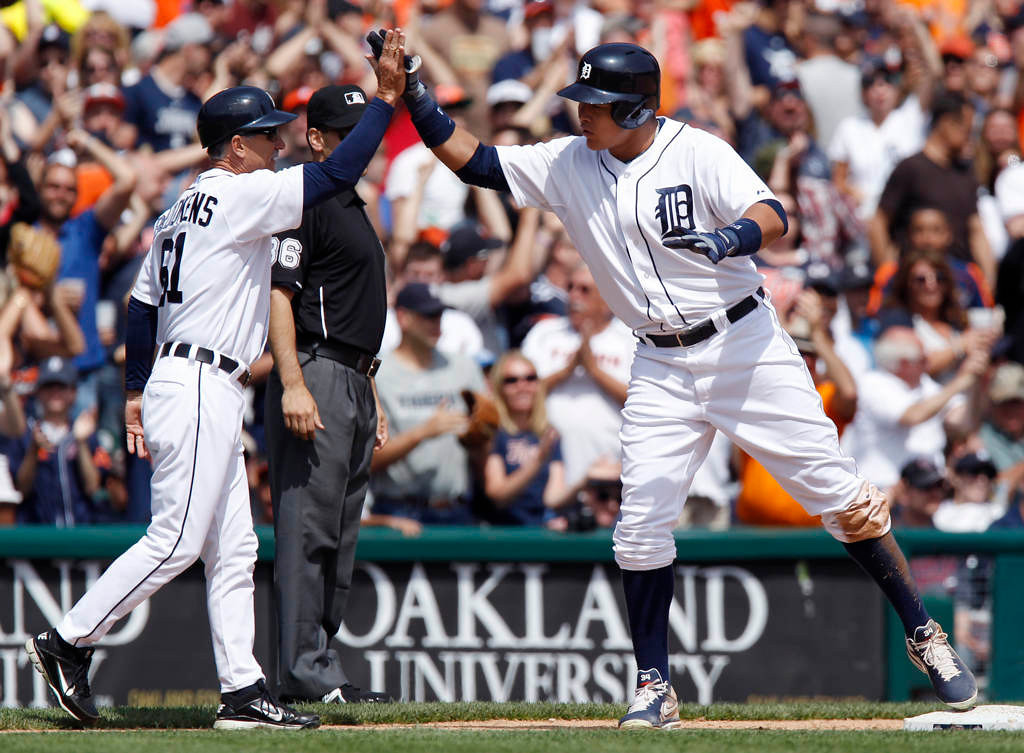 . DETROIT, MI - MAY 26:  Avisail Garcia #34 of the Detroit Tigers gets a high-five from third base coach Tom Brookens after hitting a bases loaded triple in the sixth inning at Comerica Park on May 26, 2013 in Detroit, Michigan. (Photo by Duane Burleson/Getty Images)