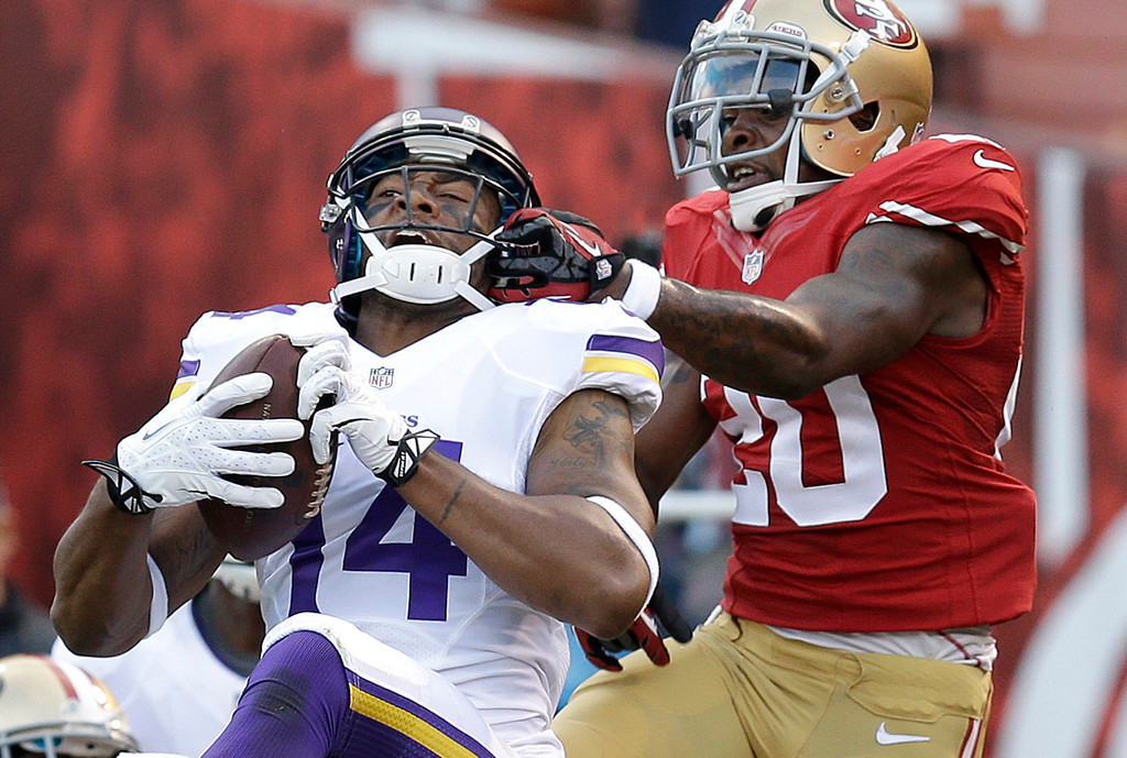 . Vikings wide receiver Joe Webb, left, catches a three-yard touchdown pass in front of 49ers defensive back Perrish Cox during the third quarter. (AP Photo/Ben Margot)