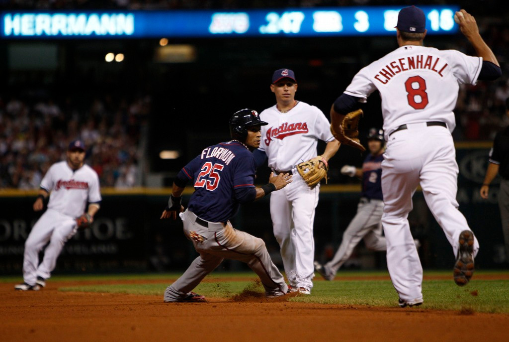 . Twins base runner Pedro Florimon is caught in a run-down between Cleveland third baseman Lonnie Chisenhall, right, and shortstop Asdrubal Cabrera during the seventh inning.   (Photo by David Maxwell/Getty Images)